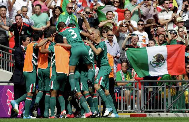 Mexico players celebrate a goal by teammate Oribe Peralta during the men's soccer final against Brazil at the 2012 Summer Olympics, Saturday, Aug. 11, 2012, in London. (AP Photo/Hassan Ammar) Photo: Hassan Ammar / AP