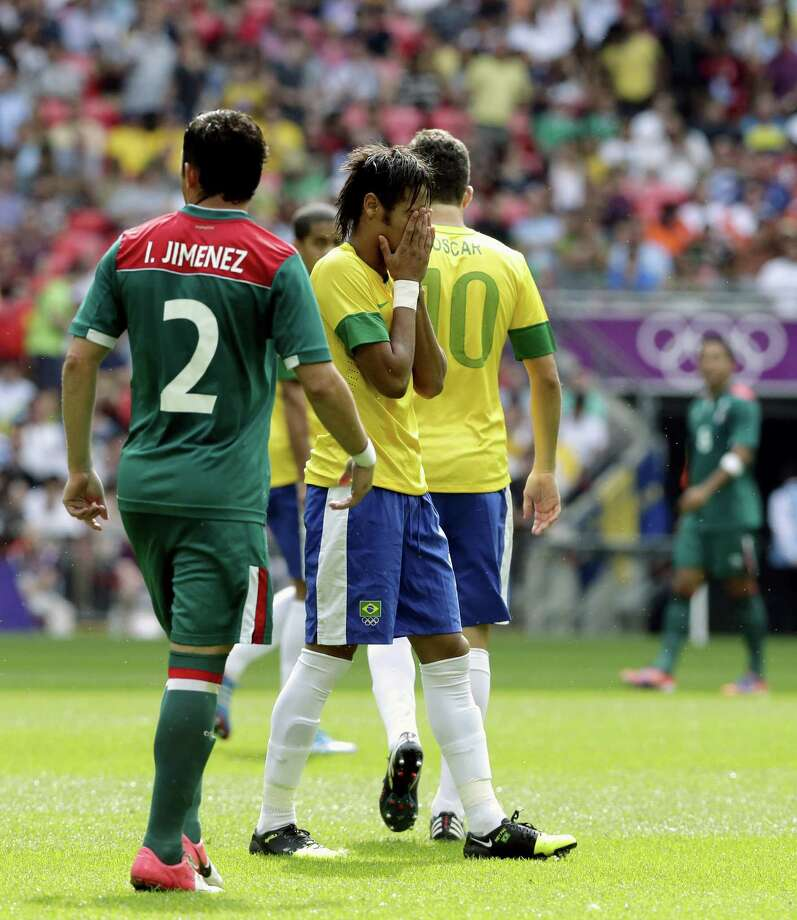 Brazil's Neymar, center, reacts as Mexico's Israel Jimenez (2) walks by during the men's soccer final at the 2012 Summer Olympics, Saturday, Aug. 11, 2012, in London. (AP Photo/Luca Bruno) Photo: Luca Bruno / AP
