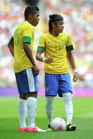 LONDON, ENGLAND - AUGUST 11: Alex Sandro of Brazil and Neymar of Brazil look on during the Men's Football Final between Brazil and Mexico on Day 15 of the London 2012 Olympic Games at Wembley Stadium on August 11, 2012 in London, England. Photo: Michael Regan, Getty Images / 2012 Getty Images