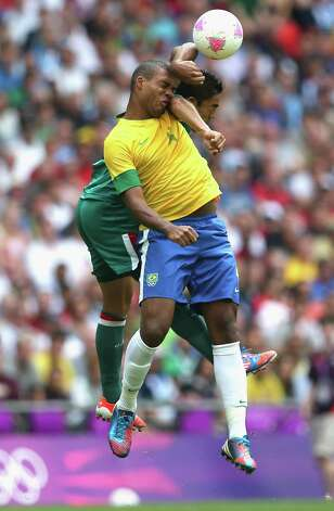 LONDON, ENGLAND - AUGUST 11:  Juan Jesus of Brazil goes up for the ball during the Men's Football Final between Brazil and Mexico on Day 15 of the London 2012 Olympic Games at Wembley Stadium on August 11, 2012 in London, England. Photo: Julian Finney, Getty Images / 2012 Getty Images