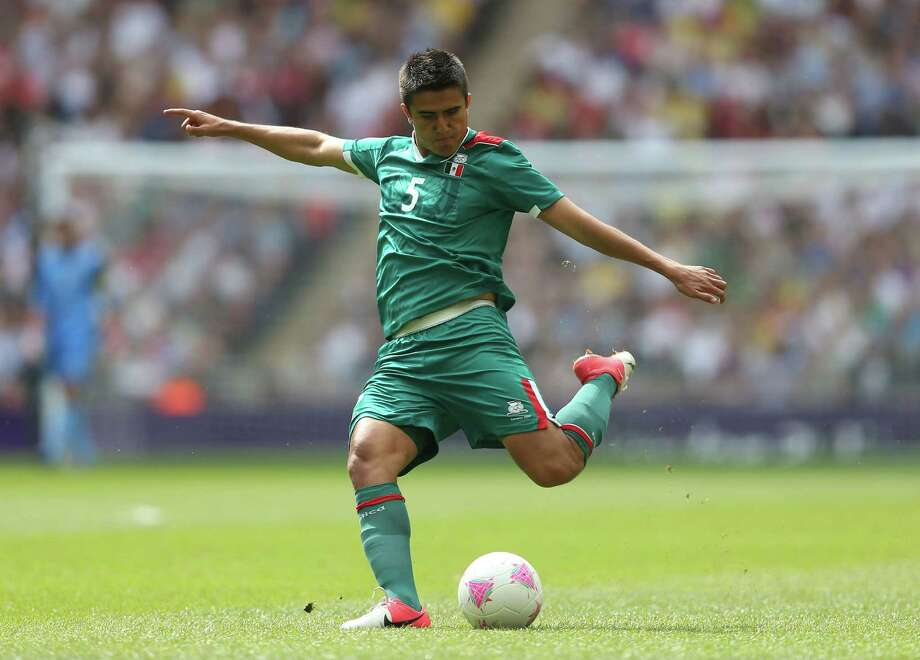 LONDON, ENGLAND - AUGUST 11:  Darvin Chavez of Mexico clears the ball during the Men's Football Final between Brazil and Mexico on Day 15 of the London 2012 Olympic Games at Wembley Stadium on August 11, 2012 in London, England. Photo: Julian Finney, Getty Images / 2012 Getty Images