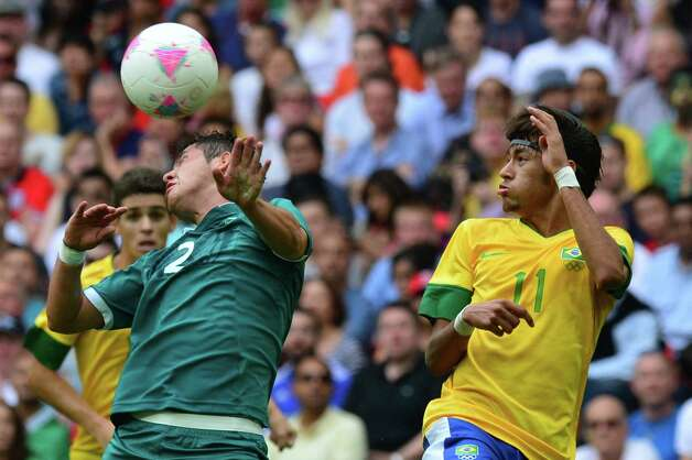 Mexico's defender Israel Jimenez (L) and Brazil's forward Neymar fight for the ball in the men's football final match between Brazil and Mexico at Wembley stadium during the London Olympic Games on August 11, 2012.     AFP PHOTO / LUIS ACOSTALUIS ACOSTA/AFP/GettyImages Photo: LUIS ACOSTA, AFP/Getty Images / AFP