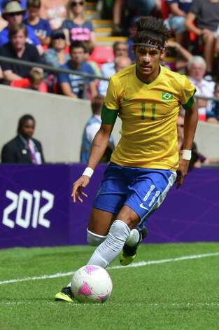 Brazil's forward Neymar runs with the ball in the men's football final match between Brazil and Mexico at Wembley stadium in London during the London Olympic Games on August 11, 2012.     AFP PHOTO / LUIS ACOSTALUIS ACOSTA/AFP/GettyImages Photo: LUIS ACOSTA, AFP/Getty Images / AFP