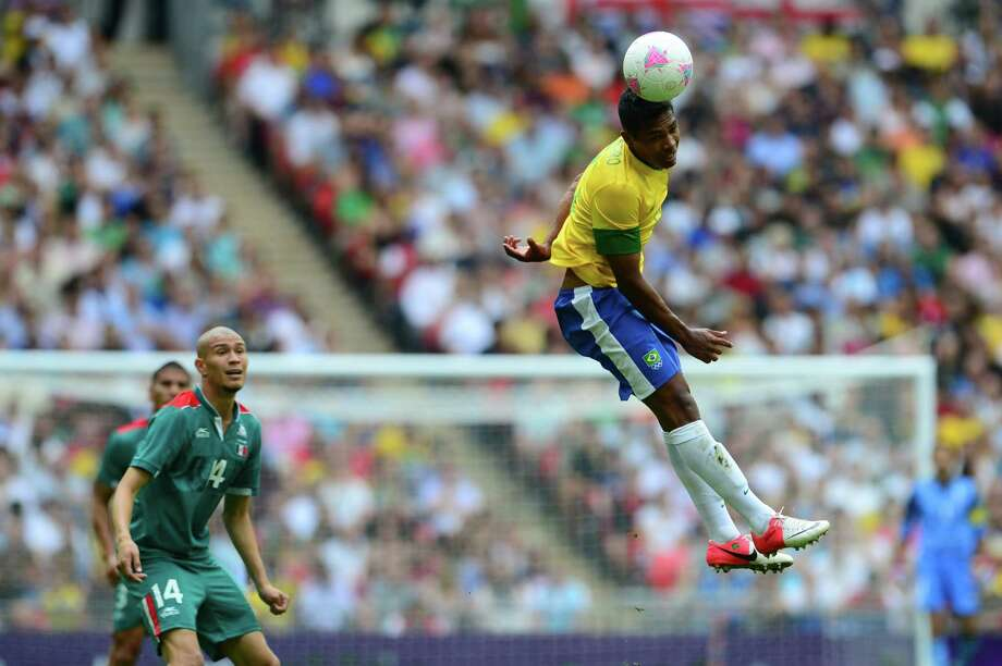 Brazil's midfielder Sandro (R) heads the ball in the men's football final match between Brazil and Mexico at Wembley stadium during the London Olympic Games on August 11, 2012.      AFP PHOTO / MARTIN BERNETTIMARTIN BERNETTI/AFP/GettyImages Photo: MARTIN BERNETTI, AFP/Getty Images / AFP