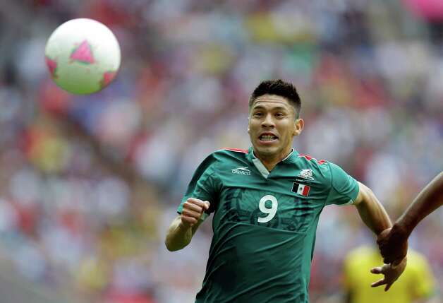 Mexico's Oribe Peralta (9) controls the ball against Brazil during the men's soccer final at the 2012 Summer Olympics, Saturday, Aug. 11, 2012, in London. (AP Photo/Hussein Malla) Photo: Hussein Malla, Associated Press / AP