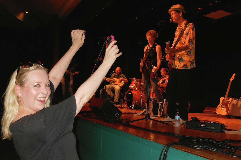 Carleigh Welsh, the Levitt Pavilion'smarketing and communications director, lets loose at a River City Slim  & The Zydeco Hogs concert Friday night. Photo: Mike Lauterborn / Westport News contributed