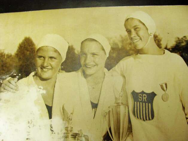 Norwalk native Marie Corridon Mortell, center, in a photograph taken at the Olympic trials leading up to the 1948 Summer Olympic Games in London, where she took home gold in the 4 X 100 freestyle relay. The photo in on display at the Norwalk YMCA. Photo: Meg Barone