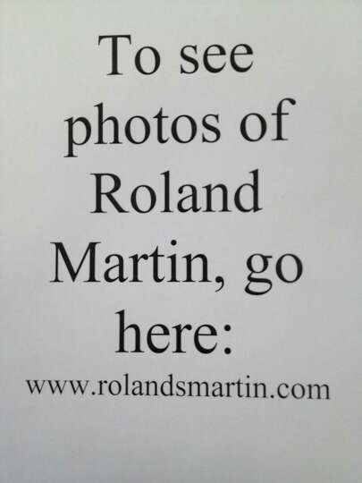We couldn't find photos of columnist Roland Martin, so visit his website to see what he looks lik