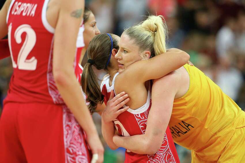 LONDON, ENGLAND - AUGUST 11: Lauren Jackson #15 of Australia hugs Becky Hammon #9 of Russia after Australia won 83-74 during the Women's Basketball Bronze Medal game on Day 15 of the London 2012 Olympic Games at North Greenwich Arena on August 11, 2012 in London, England.