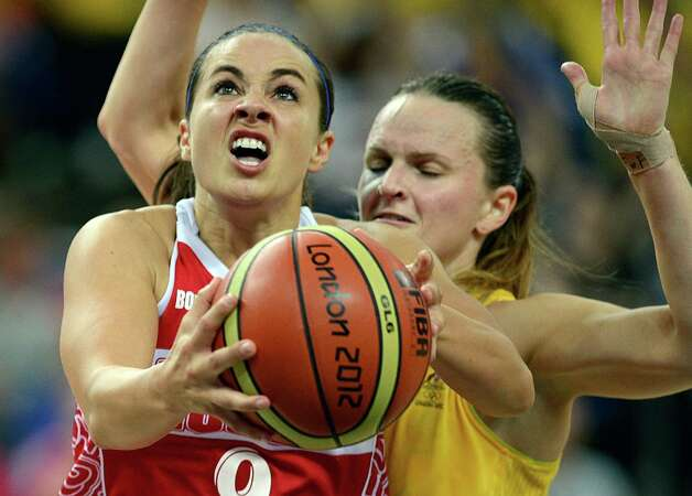 Australian guard Jennifer Screen (back) challenges Russian guard Becky Hammon during the London 2012 Olympic Games women's bronze medal basketball game between Australia and Russia at the North Greenwich Arena in London on August 11, 2012. AFP PHOTO /TIMOTHY A.  CLARYTIMOTHY A. CLARY/AFP/GettyImages Photo: TIMOTHY A. CLARY, AFP/Getty Images / AFP