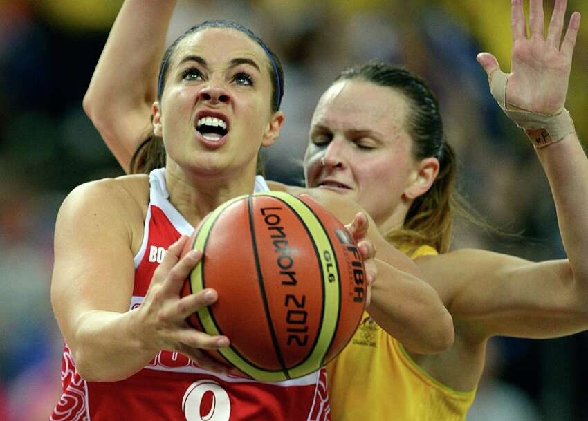 Australian guard Jennifer Screen (back) challenges Russian guard Becky Hammon during the London 2012 Olympic Games women's bronze medal basketball game between Australia and Russia at the North Greenwich Arena in London on August 11, 2012. AFP PHOTO /TIMOTHY A. CLARYTIMOTHY A. CLARY/AFP/GettyImages