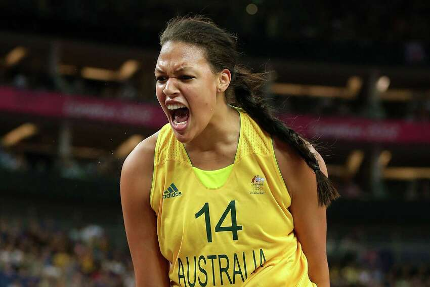 LONDON, ENGLAND - AUGUST 11: Liz Cambage #14 of Australia reacts in the first half against Russia during the Women's Basketball Bronze Medal game on Day 15 of the London 2012 Olympic Games at North Greenwich Arena on August 11, 2012 in London, England.