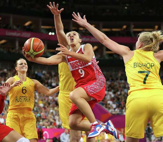 LONDON, ENGLAND - AUGUST 11:  Becky Hammon #9 of Russia drives for a shot attempt against Abby Bishop #7 of Australia during the Women's Basketball Bronze Medal game on Day 15 of the London 2012 Olympic Games at North Greenwich Arena on August 11, 2012 in London, England. Photo: Christian Petersen, Getty Images / 2012 Getty Images