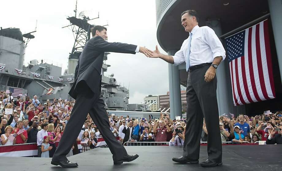 Mitt Romney greets running mate Paul Ryan (left) on Saturday in Norfolk, Va. Photo: Saul Loeb, AFP/Getty Images