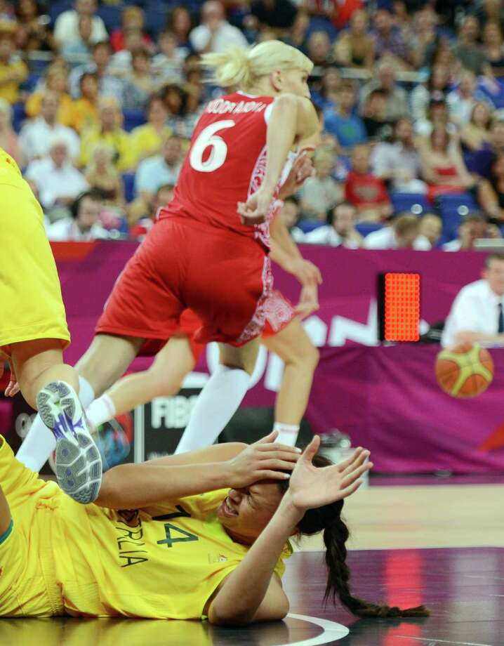 Australian center Elizabeth Cambage falls to the ground as she vies with Russian forward Natalya Vodopyanova during the London 2012 Olympic Games women's bronze medal basketball game between Australia and Russia at the North Greenwich Arena in London on August 11, 2012. AFP PHOTO /TIMOTHY A.  CLARYTIMOTHY A. CLARY/AFP/GettyImages Photo: TIMOTHY A. CLARY, AFP/Getty Images / AFP