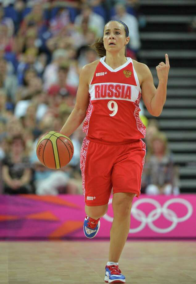 Russian guard Becky Hammon runs with the ball during the London 2012 Olympic Games women's bronze medal basketball game between Australia and Russia at the North Greenwich Arena in London on August 11, 2012. AFP PHOTO /MARK RALSTONMARK RALSTON/AFP/GettyImages Photo: MARK RALSTON, AFP/Getty Images / AFP