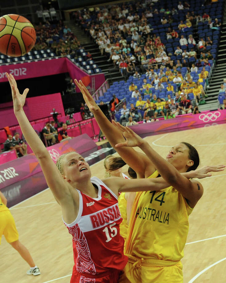 Australian center Elizabeth Cambage (R) challenges Russian centre Nadezhda Grishaeva during the London 2012 Olympic Games women's bronze medal basketball game between Australia and Russia at the North Greenwich Arena in London on August 11, 2012. AFP PHOTO POOL/MARK RALSTONMARK RALSTON/AFP/GettyImages Photo: MARK RALSTON, AFP/Getty Images / AFP