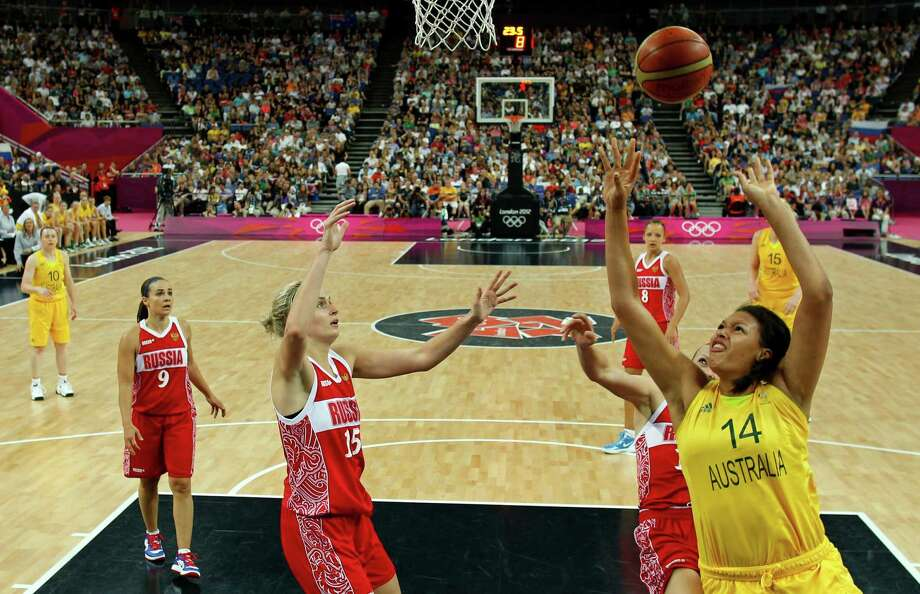 Australia's Liz Cambage (R) puts up a shot against Russia during the London 2012 Olympic Games women's bronze medal basketball game between Australia and Russia at the North Greenwich Arena in London on August 11, 2012. AFP PHOTO POOL/SERGIO PEREZSERGIO PEREZ/AFP/GettyImages Photo: SERGIO PEREZ, AFP/Getty Images / AFP