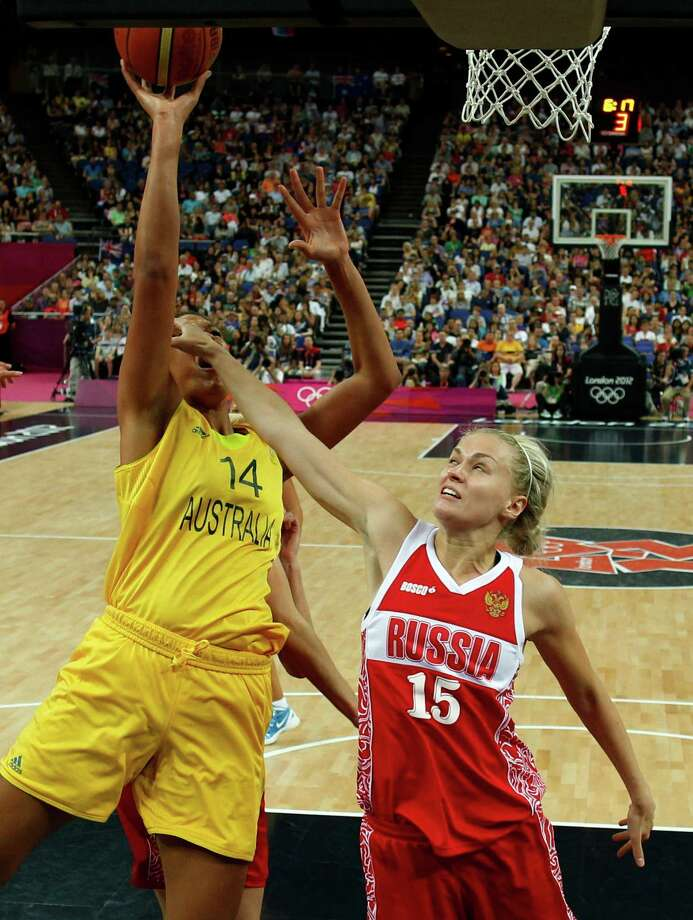Russia's Nadezhda Grishaeva (R) guards Australia's Liz Cambage during the London 2012 Olympic Games women's bronze medal basketball game between Australia and Russia at the North Greenwich Arena in London on August 11, 2012. AFP PHOTO POOL/SERGIO PEREZSERGIO PEREZ/AFP/GettyImages Photo: SERGIO PEREZ, AFP/Getty Images / AFP