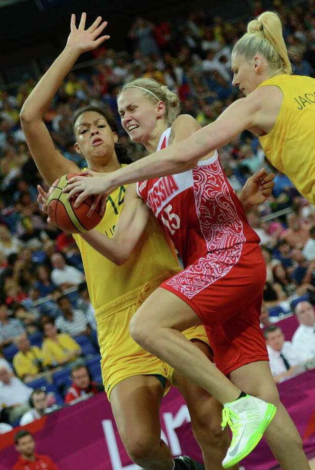 Australian center Elizabeth Cambage (L) challenges Russian centre Nadezhda Grishaeva (C) during the London 2012 Olympic Games women's bronze medal basketball game between Australia and Russia at the North Greenwich Arena in London on August 11, 2012. AFP PHOTO /TIMOTHY A.  CLARYTIMOTHY A. CLARY/AFP/GettyImages Photo: TIMOTHY A. CLARY, AFP/Getty Images / AFP