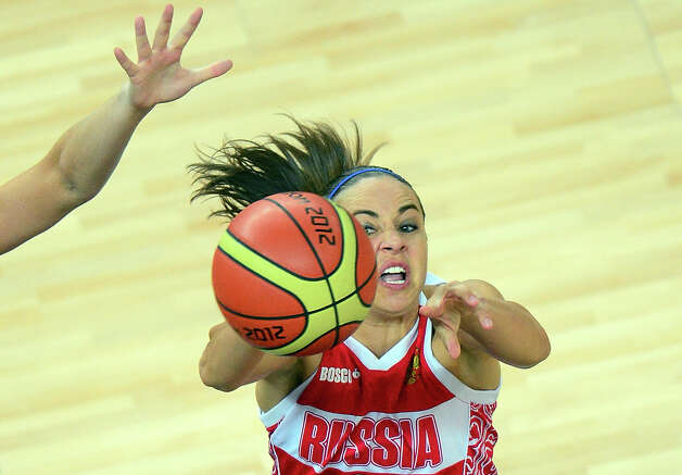 Russian guard Becky Hammon shoots the ball  during the London 2012 Olympic Games women's bronze medal basketball game between Australia and Russia at the North Greenwich Arena in London on August 11, 2012. AFP PHOTO /EMMANUEL DUNANDEMMANUEL DUNAND/AFP/GettyImages Photo: EMMANUEL DUNAND, AFP/Getty Images / AFP