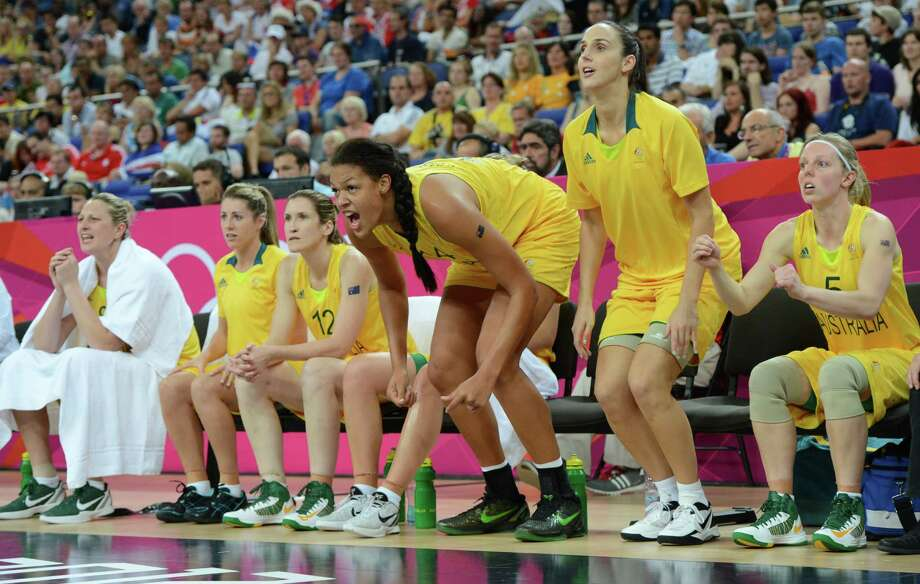 Australian center Elizabeth Cambage cheers her teammates from the sidelines during the London 2012 Olympic Games women's bronze medal basketball game between Australia and Russia at the North Greenwich Arena in London on August 11, 2012. AFP PHOTO /MARK RALSTONMARK RALSTON/AFP/GettyImages Photo: MARK RALSTON, AFP/Getty Images / AFP