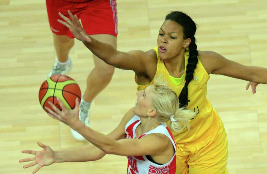 Australian center Elizabeth Cambage (R) challenges Russian forward Natalya Vodopyanova during the London 2012 Olympic Games women's bronze medal basketball game between Australia and Russia at the North Greenwich Arena in London on August 11, 2012. AFP PHOTO /EMMANUEL DUNANDEMMANUEL DUNAND/AFP/GettyImages Photo: EMMANUEL DUNAND, AFP/Getty Images / AFP