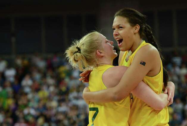 Australian forward Abby Bishop (L) and Australian center Elizabeth Cambage (R) celebrate winning 83-74 against Russia during the London 2012 Olympic Games women's bronze medal basketball game between Australia and Russia at the North Greenwich Arena in London on August 11, 2012. AFP PHOTO /MARK RALSTONMARK RALSTON/AFP/GettyImages Photo: MARK RALSTON, AFP/Getty Images / AFP
