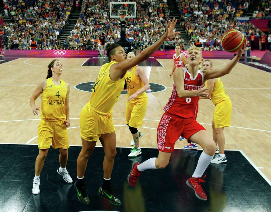 Russia's Natalya Vodopyanova (R) shoots past Australia's Liz Cambage (C) during the London 2012 Olympic Games women's bronze medal basketball game between Australia and Russia at the North Greenwich Arena in London on August 11, 2012. AFP PHOTO /POOL/SERGIO PEREZSERGIO PEREZ/AFP/GettyImages Photo: SERGIO PEREZ, AFP/Getty Images / AFP