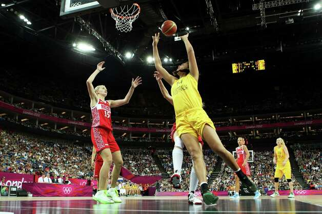 LONDON, ENGLAND - AUGUST 11:  Liz Cambage #14 of Australia attempts a shot in the first half against Nadezhda Grishaeva #15 of Russia  during the Women's Basketball Bronze Medal game on Day 15 of the London 2012 Olympic Games at North Greenwich Arena on August 11, 2012 in London, England. Photo: Christian Petersen, Getty Images / 2012 Getty Images