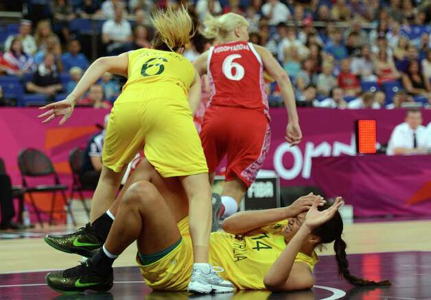 Australian center Elizabeth Cambage falls to the ground during the London 2012 Olympic Games women's bronze medal basketball game between Australia and Russia at the North Greenwich Arena in London on August 11, 2012. AFP PHOTO /TIMOTHY A.  CLARYTIMOTHY A. CLARY/AFP/GettyImages Photo: TIMOTHY A. CLARY, AFP/Getty Images / AFP
