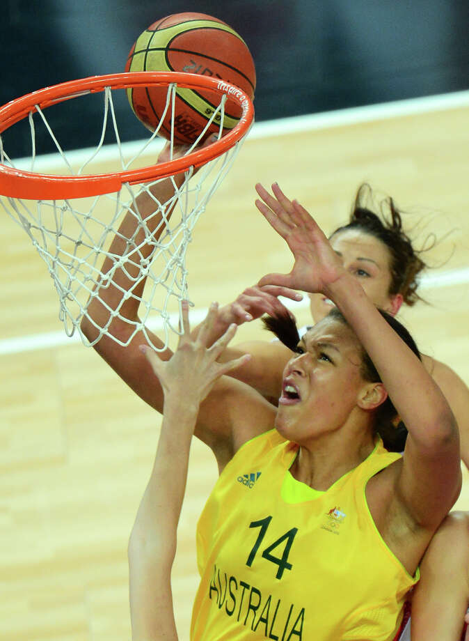 Australian center Elizabeth Cambage (front) jumps for the ball during the London 2012 Olympic Games women's bronze medal basketball game between Australia and Russia at the North Greenwich Arena in London on August 11, 2012. AFP PHOTO /EMMANUEL DUNANDEMMANUEL DUNAND/AFP/GettyImages Photo: EMMANUEL DUNAND, AFP/Getty Images / AFP