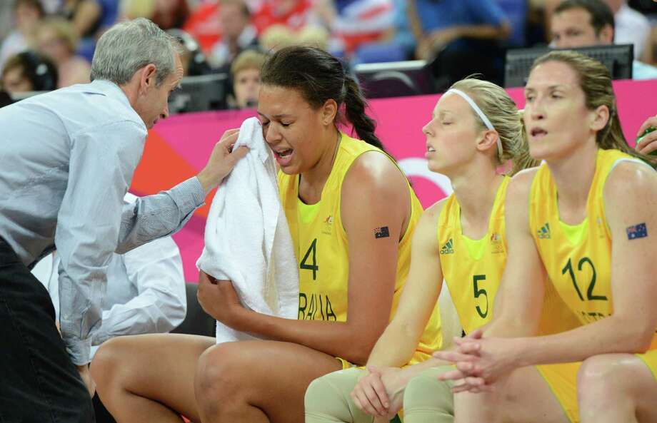 Australian center Elizabeth Cambage receives medical attention on the sidelines during the London 2012 Olympic Games women's bronze medal basketball game between Australia and Russia at the North Greenwich Arena in London on August 11, 2012. AFP PHOTO /MARK RALSTONMARK RALSTON/AFP/GettyImages Photo: MARK RALSTON, AFP/Getty Images / AFP
