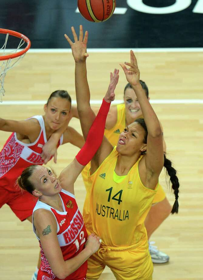 Russian centre Irina Osipova (L) jumps for the ball with Australian center Elizabeth Cambage during the London 2012 Olympic Games women's bronze medal basketball game between Australia and Russia at the North Greenwich Arena in London on August 11, 2012. AFP PHOTO /EMMANUEL DUNANDEMMANUEL DUNAND/AFP/GettyImages Photo: EMMANUEL DUNAND, AFP/Getty Images / AFP