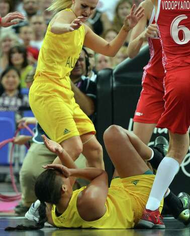 Australian center Elizabeth Cambage falls to the ground during the London 2012 Olympic Games women's bronze medal basketball game between Australia and Russia at the North Greenwich Arena in London on August 11, 2012. AFP PHOTO /MARK RALSTONMARK RALSTON/AFP/GettyImages Photo: MARK RALSTON, AFP/Getty Images / AFP