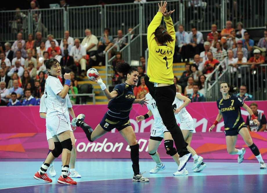 Veronica Cuadrado Dehesa of Spain prepares to shoot against South Korea's coach Kang Jae Won during the women's handball bronze medal match between Spain and Korea on Saturday..  (Photo by Pascal Le Segretain/Getty Images) Photo: Pascal Le Segretain, Ap/getty / 2012 Getty Images