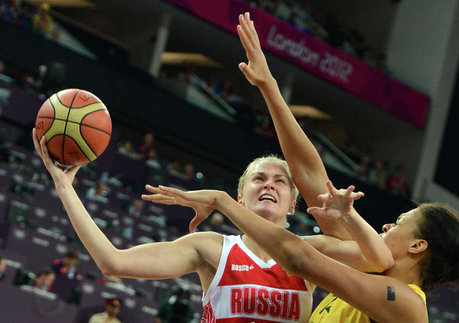 Australian center Elizabeth Cambage (R) challenges Russian forward Natalya Zhedik during the London 2012 Olympic Games women's bronze medal basketball game between Australia and Russia at the North Greenwich Arena in London on August 11, 2012. AFP PHOTO /MARK RALSTONMARK RALSTON/AFP/GettyImages Photo: MARK RALSTON, AFP/Getty Images / AFP
