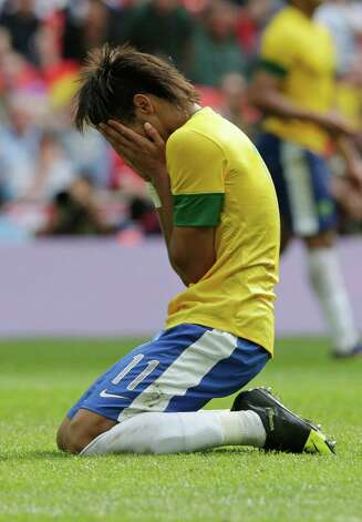Brazil's Neymar reacts during the men's soccer final against Mexico on Saturday. Mexico won 2-1.  (AP Photo/Luca Bruno) Photo: Ap/getty