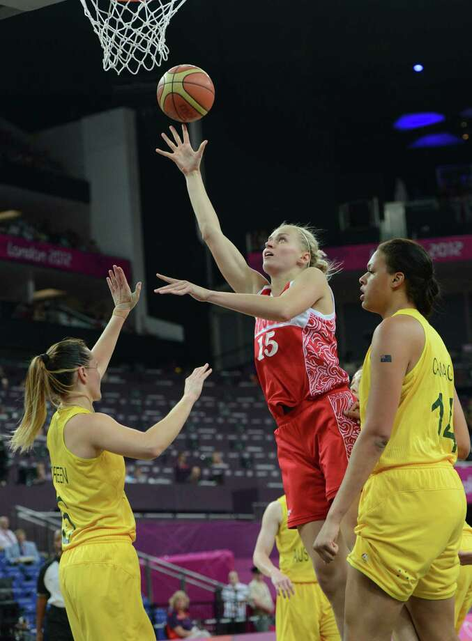 Russian centre Nadezhda Grishaeva (C) jumps to score over Australian guard Jennifer Screen (L) and Australian center Elizabeth Cambage (R) during the London 2012 Olympic Games women's bronze medal basketball game between Australia and Russia at the North Greenwich Arena in London on August 11, 2012. AFP PHOTO /MARK RALSTONMARK RALSTON/AFP/GettyImages Photo: MARK RALSTON, AFP/Getty Images / AFP