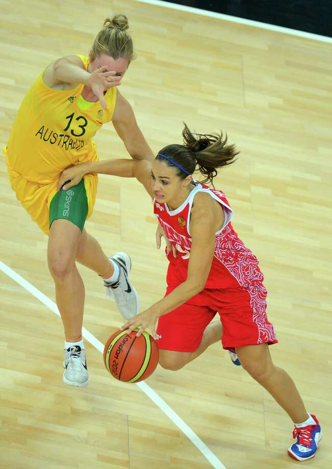 Russian guard Becky Hammon (R) is challenged by Australian forward Rachel Jarry during the London 2012 Olympic Games women's bronze medal basketball game between Australia and Russia at the North Greenwich Arena in London on August 11, 2012. AFP PHOTO /EMMANUEL DUNANDEMMANUEL DUNAND/AFP/GettyImages Photo: EMMANUEL DUNAND, AFP/Getty Images / AFP