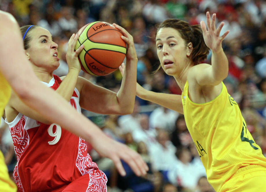 Russian guard Becky Hammon (L) is challenged by Australian forward Jenna O'Hea during the London 2012 Olympic Games women's bronze medal basketball game between Australia and Russia at the North Greenwich Arena in London on August 11, 2012. AFP PHOTO /TIMOTHY A.  CLARYTIMOTHY A. CLARY/AFP/GettyImages Photo: TIMOTHY A. CLARY, AFP/Getty Images / AFP