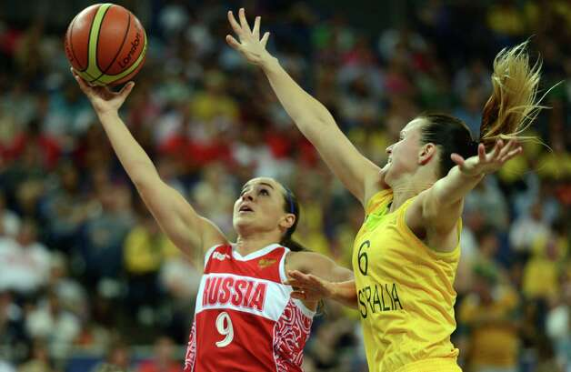 Australian guard Jennifer Screen (R) challenges Russian guard Becky Hammon during the London 2012 Olympic Games women's bronze medal basketball game between Australia and Russia at the North Greenwich Arena in London on August 11, 2012. AFP PHOTO /TIMOTHY A.  CLARYTIMOTHY A. CLARY/AFP/GettyImages Photo: TIMOTHY A. CLARY, AFP/Getty Images / AFP