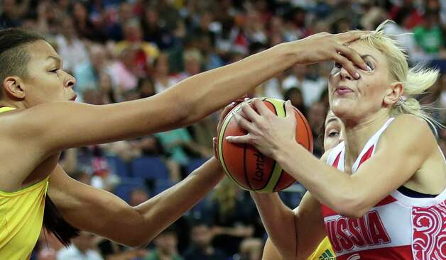 Australia's Elizabeth Cambage jams her finger into the eye of Russia's Natalya Vodopyanova while defending a drive to the basket during a women's bronze medal basketball game at the 2012 Summer Olympics, Saturday, Aug. 11, 2012, in London. (AP Photo/Charles Krupa) Photo: Charles Krupa, Associated Press / AP