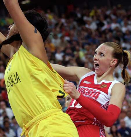 Russia's Irina Osipova, right, grabs the shirt of Australia's Elizabeth Cambage on a drive to the basket during a women's bronze medal basketball game at the 2012 Summer Olympics, Saturday, Aug. 11, 2012, in London. (AP Photo/Charles Krupa) Photo: Charles Krupa, Associated Press / AP