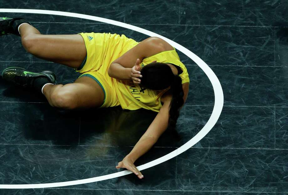 Australia's Elizabeth Cambage reacts after falling during the women's basketball bronze medal game against Russia at the 2012 Summer Olympics, Saturday, Aug. 11, 2012, in London. (AP Photo/Victor R. Caivano) Photo: Victor R. Caivano, Associated Press / AP