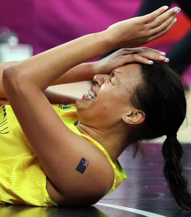 Australia's Elizabeth Cambage holds her head after getting elbowed while shooting against Russia during the women's bronze medal basketball game at the 2012 Summer Olympics, Saturday, Aug. 11, 2012, in London. (AP Photo/Charles Krupa) Photo: Charles Krupa, Associated Press / AP