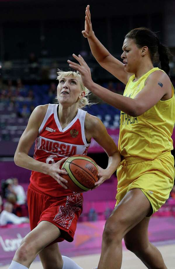 Russia's Natalya Vodopyanova, left, drives to the basket as Australia's Elizabeth Cambage, right, defends during a women's bronze medal basketball game at the 2012 Summer Olympics, Saturday, Aug. 11, 2012, in London. (AP Photo/Eric Gay) Photo: Eric Gay, Associated Press / AP