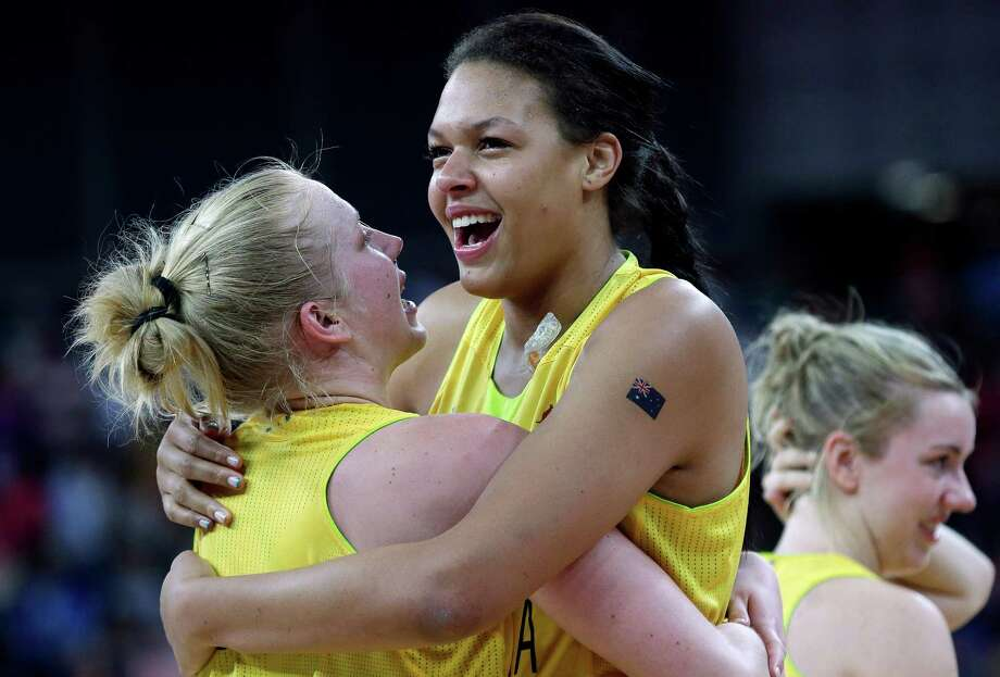 Australia's Abby Bishop, left, and Australia's Elizabeth Cambage, right, hug as they celebrate their win over Russia in a women's bronze medal basketball game at the 2012 Summer Olympics, Saturday, Aug. 11, 2012, in London. (AP Photo/Eric Gay) Photo: Eric Gay, Associated Press / AP
