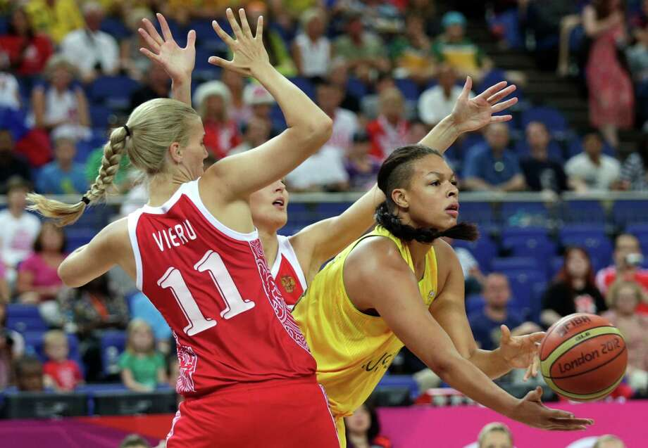 Australia's Elizabeth Cambage, right, passes the ball as she is cover by Russia's Natalya Vieru during the women's bronze medal basketball game at the 2012 Summer Olympics, Saturday, Aug. 11, 2012, in London. (AP Photo/Charles Krupa) Photo: Charles Krupa, Associated Press / AP