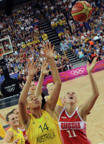Australia's Elizabeth Cambage (14) and Russia's Natalya Vieru (11) vie for possession during the women's basketball bronze medal game at the 2012 Summer Olympics, Saturday, Aug. 11, 2012, in London. (AP Photo/Mark Ralston, Pool) Photo: Mark Ralston, Associated Press / Pool AFP